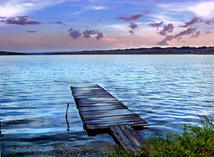 Ciudad Flores (Jonnyvargazz) Tags: sunset lake seascape flores water sunrise landscape puerto lago atardecer muelle dock agua guatemala jetty ciudad amanecer tikal anochecer riverscape petén