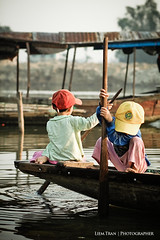 The children of the Huong Giang river (Perfume River) (Liem.Tran) Tags: children photography asia vietnamese child streetphotography vietnam perfumeriver 2010 indochina ef85mmf18 hu thathinhu canoneos500d snghng trem sngnc dulchvitnam vn liemtran tthue cucsngthngngy nhipnhngph imperialhuecity drivetheboat thechildrenofthehuonggiangriver snghnggiang huonggiangriver