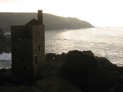The Crowns mine. (offshoretomorrow) Tags: uk light sea sun sunlight history industry evening solitude cornwall mood shadows britain atmosphere calm cliffs mines granite stillness stives cornish botallack tinmines stjust pendeen coppermines