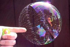 Exploding bubble (TomFalconer) Tags: colors reflections soap pop poke bubble burst ripping popping exploding tearing t111