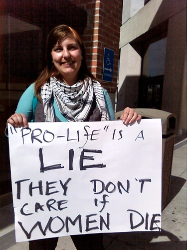 Mer Stevens demonstrates against anti-abortion group