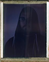 Polaroid 59 001 (Reid Haithcock) Tags: portrait selfportrait film boston analog beard polaroid glasses naturallight instant 4x5 monorail jamaicaplain largeformat graflex expiredfilm graphicview polaroid59 bummercity reidhaithcock