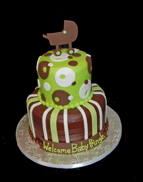 lime green and brown 2 tier baby shower cake topped with a baby carriage
