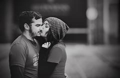 A kiss (Wojtek Piatek) Tags: kiss couple wedding engagement dublin ireland sony alpha zeiss dof blurry background guinness blackandwhite mono hat winter love 135mm