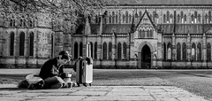 Travellers rest (phil anker) Tags: street people pov salisbury cathedral zonefocus suitcase travel tourist negativespace fujix70