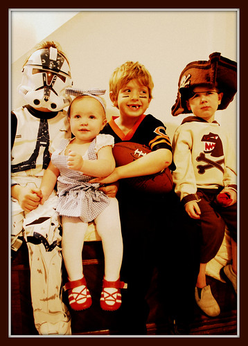 A clone trooper, dorothy, football player, & dinosaur pirate