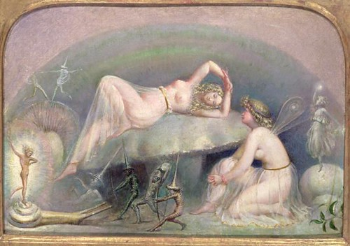 fairy resting on a mushroom..
