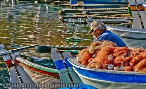 Fisherman at Amasra Wharf by voyageAnatolia