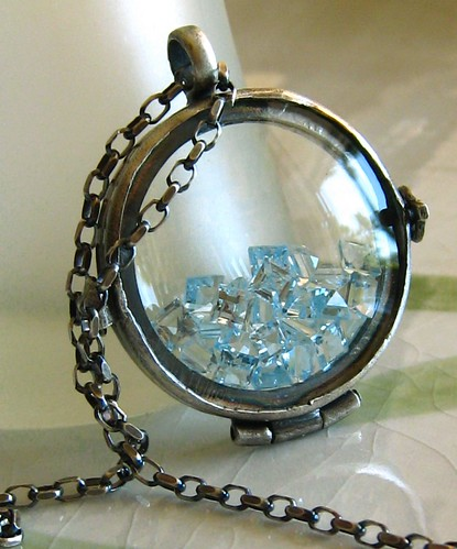 Mea Makamae - Oxidized sterling silver glass locket filled with topaz gems