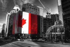 The World's Largest Canadian Flag (Brandon Godfrey) Tags: world pictures street city wallpaper people urban bw canada streets color colour bus monochrome st vancouver buildings landscape photography big scenery downtown day cityscape bc metro photos pics earth britishcolumbia flag sony free scene canadian western pacificnorthwest pro northamerica metropolis dslr hdr highdynamicrange highrises 2010 selective pacificcentre lowermainland a300 backround royalbanktower photomatix tonemapped tonemapping hotelgeorgi