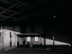 man & child (Ian Brumpton) Tags: street blackandwhite bw london blackwhite noiretblanc candid streetphotography highcontrast monochromatic busstop londres biancoenero londonstreetphotography scattidistrada amomentofreflection neroamet blackwhiteheartbeats lsp15