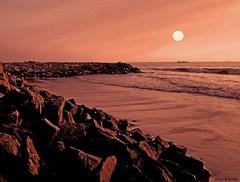 On the Rocks....Calicut beach (aroon_kalandy) Tags: light sunset orange india beach nature beauty composite creativity adobephotoshop artistic awesome kerala fantasy greatshot impressions naturelovers calicut beautifulshot anawesomeshot malayalikkoottam sonyh50 aroonkalandy theoriginalgoldseal