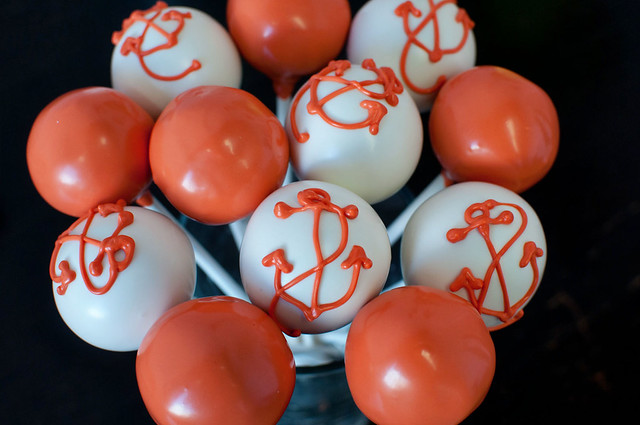 orange and white anchor cake pops