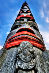 Totem Tower (Surrealize) Tags: seattle wood blue red sky sculpture cloud detail tower monument island coast washington nikon focus paint dof village waterfront northwest artistic native spirit indian chief grain perspective culture totem pole american cedar blake hdr reservation storytelling tillicum 9exp d700 surrealize