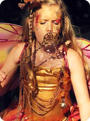 Fairy Bubbles (Flan de Coco) Tags: pink blue costumes girls musician sun silly cute girl festival kids children fun gold kid wings pretty artist texas child play purple tx innocent adorable sunny bubbles sprite pixie trf fairy fantasy precious renfaire fairies facepaint crazyhair pixies performer sprites worldmusic gypsy nymph playful folkmusic fairys renaissance renfest faerie faeries talented nymphs flutter blowingbubbles garb fairie bluefairy celticmusic texasrenaissancefestival flowerhair 1001dreams toddmission circapaleo
