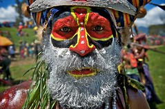 Colorful Face, Colorful People (Dave Schreier) Tags: new old blue red white man face yellow festival beard island nose star guinea eyes paint mt pacific tribal lips stare papua hagen
