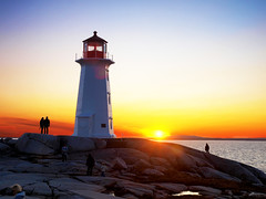 last rays (paul bica) Tags: ocean sunset sky lighthouse tourism nature water outdoors rocks novascotia peaceful atlantic halifax peggyscove dex peggyspoint dexxus 20090827cabot1950