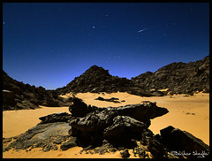 The Shooting Star ! (Bashar Shglila) Tags: moon mountains stone night stars star landscapes rocks long exposure shot desert tail surface full fallen shooting swift sands libya tuttle magnificent acacus libyen adad    akakus   lbia   libi swifttuttle libiya sahran akakous liviya  libija adade      thepowerofnow   lbija  lby libja lbya liiba livi   acacous   akakos acacos