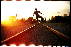Explosions in the Sky (orangetuwie) Tags: railroad light sun color film train 35mm golden brother tracks slide electro heel click gsn yashica brea 100iso afga