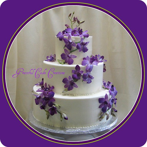 Ivory Wedding Cake with Purple Orchids