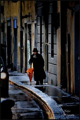 who cares if we get wet? (andzer) Tags: street people italy wet rain lady umbrella nikon scout andreas explore firenze 2010 myfaves decisive d300 zervas andzer wwwandzergr