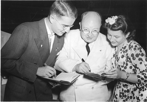Paul E. Teschan (1923- ), Watson Davis (1896-1967), and Marina Prajmovsky (1924-1974), 1942, by Fremont Davis, Black-and-white photograph, Smithsonian Institution Archives, Acc. 90-105 - Science Service, Records, 1920s-1970s, SIA Acc. 90-105 (SIA2009-4099).