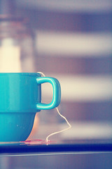 {something was changing, something i could sense even though i'd never been here before..} (Perpetual*Bliss) Tags: blue cup closeup dof tea mug candlelit