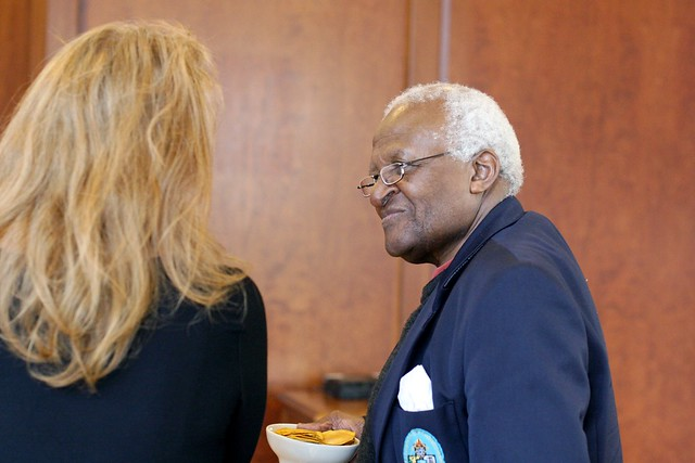 Archbishop Desmond Tutu with Krista Tippett and a Bowl of Dried Mangos