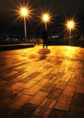 Mysteries await (Timo Erkkil) Tags: seattle travel shadow silhouette yellow night canon rebel lights raw bright geometry sigma mysterious 1020 gasworkspark starburst xsi 450d timoerkkil timoerkkila