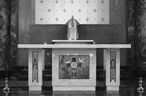 Saint Gabriel the Archangel Roman Catholic Church, in Saint Louis, Missouri, USA - Good Friday - Tabernacle is empty, and altar is stripped