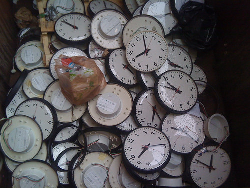 clocks in a dumpster by jasonvance, on Flickr