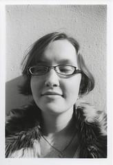 Astra Test (J. Astra Brinkmann) Tags: blackandwhite bw selfportrait film girl female self canon glasses headshot furcoat lookingdown canonae1 agfa astra 400iso agfa400