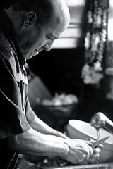 Happy Thanksgiving! :) (maysa askar) Tags: thanksgiving blackandwhite bw man home kitchen smile vegetables daddy person oscar dad sink serious bokeh bowl human cutting happythanksgiving youbettabelieveit