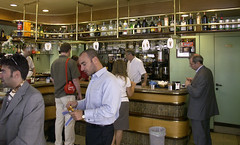 Espresso break (Toni Kaarttinen) Tags: italy milan bar cafe italia milano customer espresso cafeteria lombardia businessmen alcoholbottles