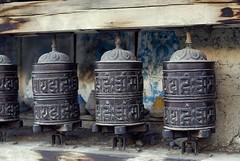 Prayer wheels, Nepal (Radosław Kut) Tags: travel nepal wall trek buddha prayer wheels backpack buddah budda annapurna mantra manang