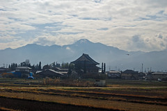 Train between Nagano and Matusomoto in Japan (JohannSchmidt) Tags: tower castle japan jo matsumoto nagano naganoprefecture  matsumotojo matsumotocastle hirajiro