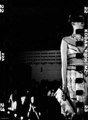 Fashion Freakout 3 (mustangbass) Tags: bw fashion weird models bn austintexas grainy holga120 analogphotography catwalk filmscan sprocket plasticcameras blackandwhitephotography sprocketholes themohawk joezito womenwithtattoos ellocobajista mustangbass josephzito canonelan35mm holgasprocketholes musiciansthatalsoshoot fashionfreakout3