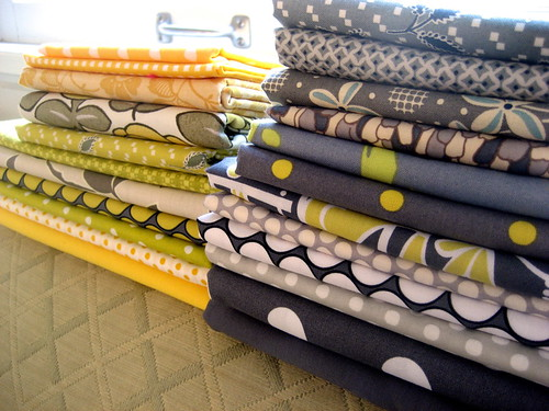 grey yellow lime fabrics stacked