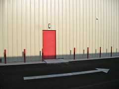 Red poles. Red door. Right arrow.