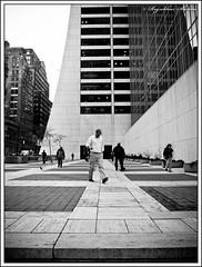 Walking home... (rssarma) Tags: nyc newyorkcity urban newyork streets monochrome blackwhite manhattan olympus distillery alleys ep2 thebigapple 1442mm microfourthirds