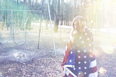 softrockstar (yyellowbird) Tags: selfportrait girl playground lights rainbow flag swings american cari