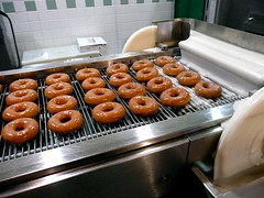 Krispy Kreme doughnuts, freshly glazed, on the production line (Scorpions and Centaurs) Tags: food shop dessert store sweet fresh krispykreme rings snack donut pastry junkfood doughnuts sugary baked glazed freshbaked conveyerbelt