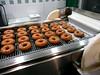 Krispy Kreme doughnuts, freshly glazed, on the production line (Scorpions and Centaurs) Tags: food shop dessert store sweet fresh krispykreme rings snack donut pastry junkfood doughnuts sugary baked glazed freshbaked conveyerbelt