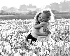 Best friends. (alibubba) Tags: girls summer blackandwhite bw field kids hug country adorable fluff dandelion summertime thebest bestfriends tutus