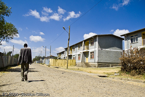 An Ethiopian man walks down the street through a wealthy part of Addis Ababa..