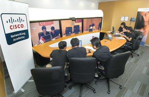 Team Cambodia and Team Thailand in the TelePresence room in Cisco's Bangkok office on Flickr by Cisco Pics