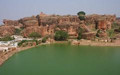 Red Sandstone Against Green is Very Easy on the Eye (Nagarjun) Tags: chalukya rockcut badamicaves