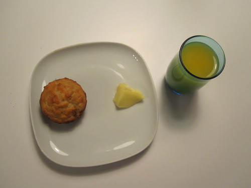 Muffin with butter, orange juice