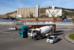 TRUCKING IN BARCELONA (Claude  BARUTEL) Tags: barcelona sea man ferry port truck boat spain ship control harbour transport police catalan trucking containers mediterranea