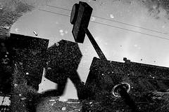 Pray for Rain (Donato Buccella / sibemolle) Tags: street blackandwhite bw italy milan reflection rain milano massiveattack puddles unbrella cordusio pozzanghere prayforrain canon400d rainingdays sibemolle fotografiastradale nonpertuttiquellicheodianolepozzanghereribaltate aftertherainalwayslookingfordirtyreflections